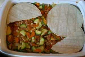 after veggie layer and a little sauce, another layer of tortillas